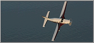 A compelling view of the PA46-500T Piper Meridian over the water                                     from above