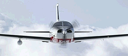 A PA46 Mirage flys above the undercast. Note the weather radar pod underneath the right wing - It is a state-of-the-art Honeywell RDR2000 color radar with a 10 inch antenna and vertical profile capability