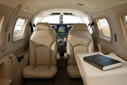 The interior of the Piper Malibu Mirage includes six adjustable leather seats refreshment accessories and a folding writing table. The PA46 Mirage is pressurized and airconditioned.